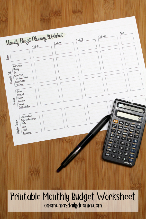 printed budget worksheet with a calculator and pen