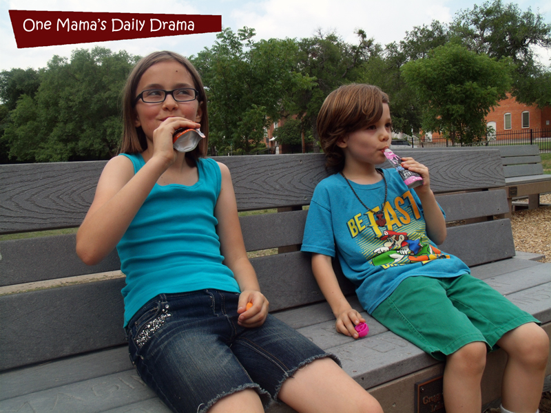 Happy kids snacking on organic Slammers