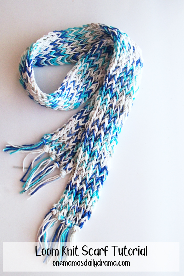 blue and white loom knit scarf on a white background