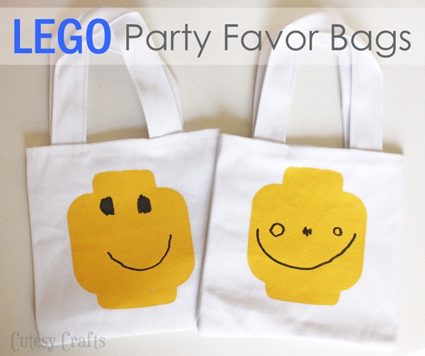lego party favor bags painted with minifigure faces from Cutesy Crafts