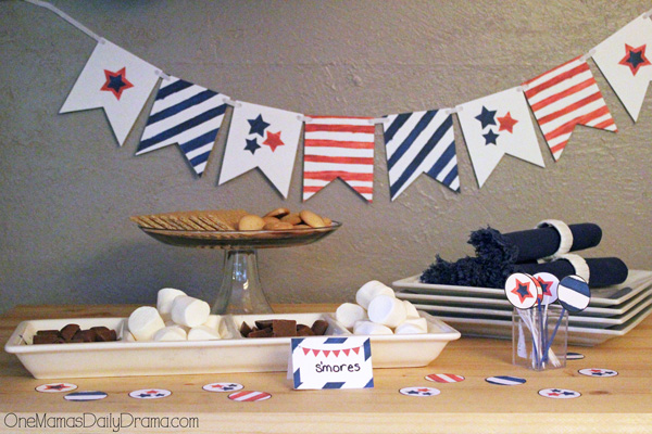 stars and stripes bunting hanging behind a table with s'mores ingredients