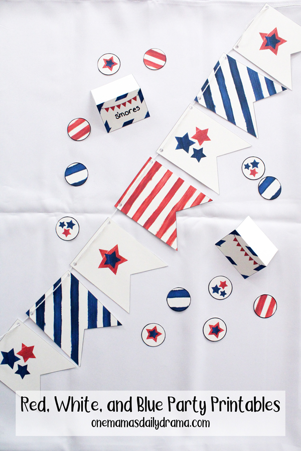 red, white, and blue stars and strips on a paper banner, circles, and tent cards
