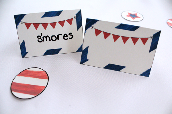 closeup of red, white, and blue party tent cards