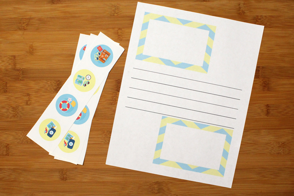 printed page with blank lines and empty boxes and a set of round stickers for a summer vacation journal