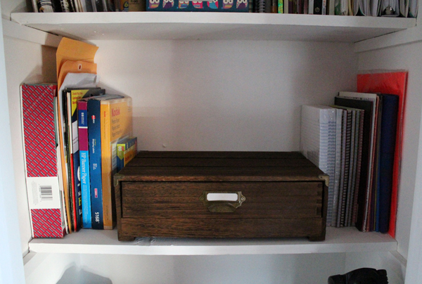 closet shelf with drawer and tidy stacked paper and folders