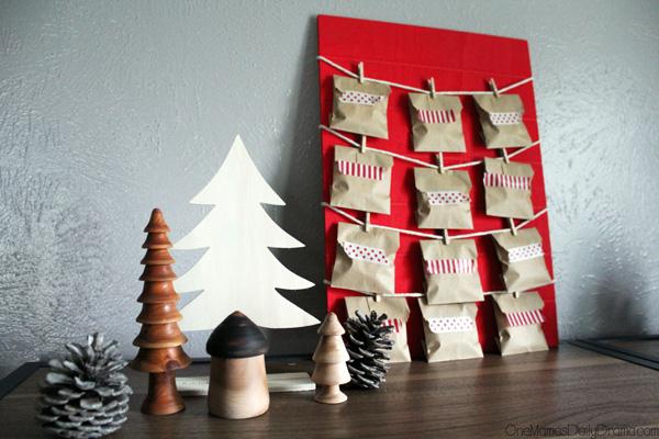 Christmas countdown calendar on a shelf beside various handmade wooden trees