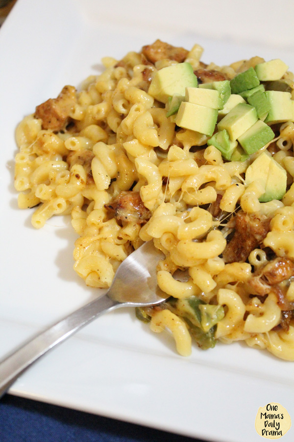 close up of chicken fajita macaroni and cheese with avocado cubes