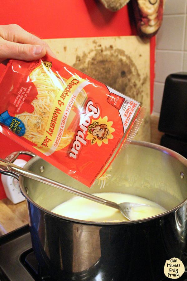 a bag of Borden® Cheese being poured into a pot