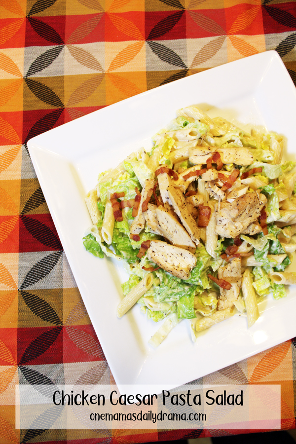 chicken caesar pasta salad on a white plate
