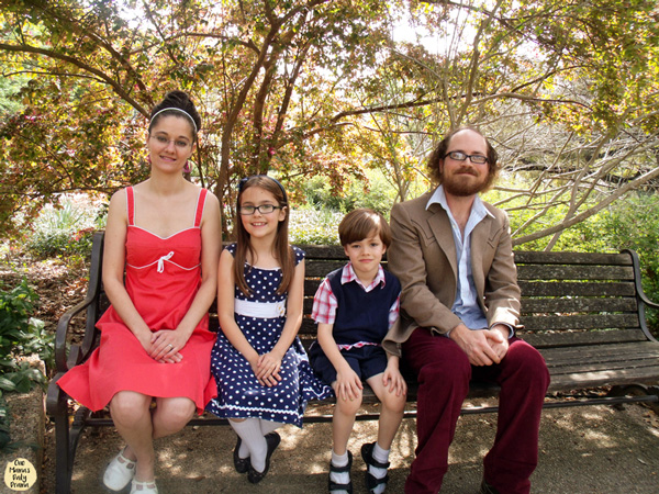 Use a tripod and timer in a public park for great family photos.