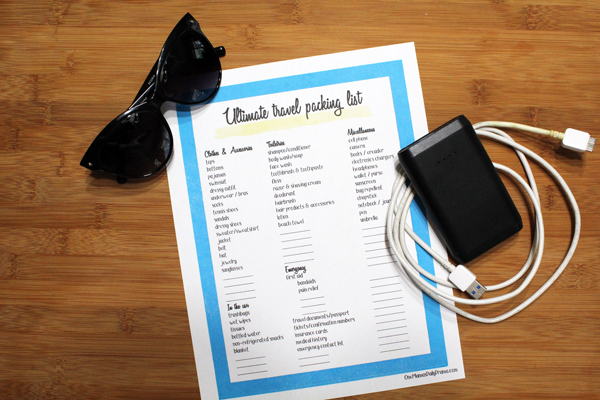 list on table with sunglasses and phone charger