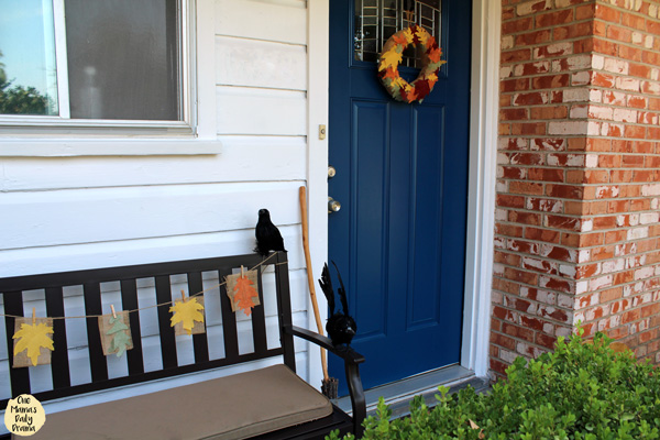 alternate view of the front porch highlighting the burlap leaf garland