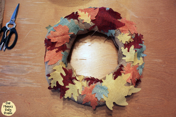 burlap wrapped wreath with colorful burlap leaves attached