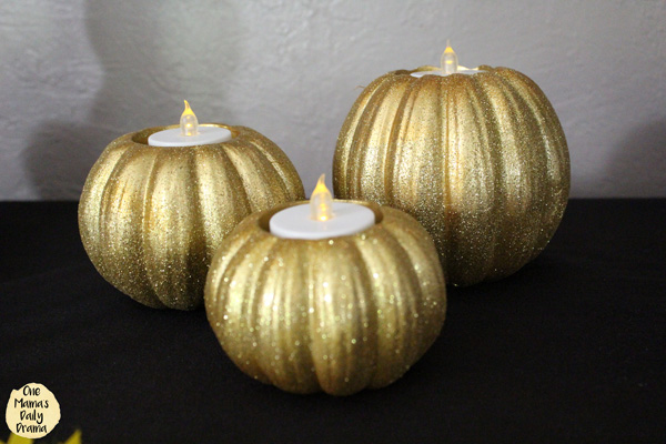 gold glittery pumpkin shaped tea light holders with electric tea light candles in the top