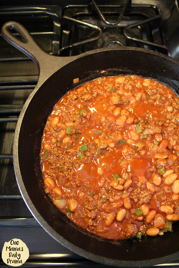 skillet with beans and tomato sauce added