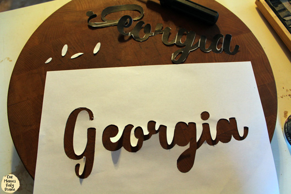 Cut out the name stencil with an Xacto knife.