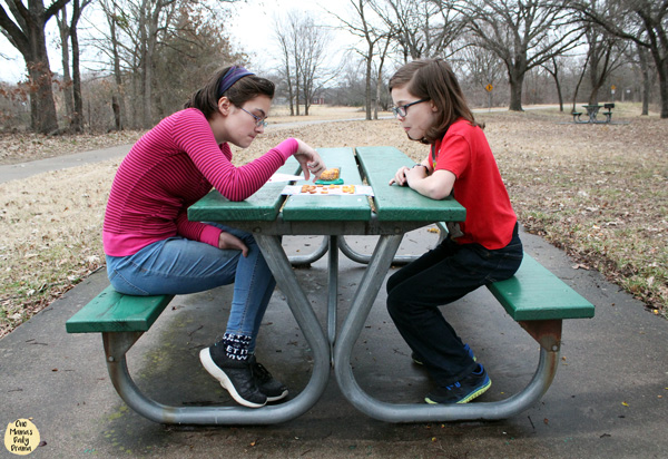 Kids playing checkers in the park