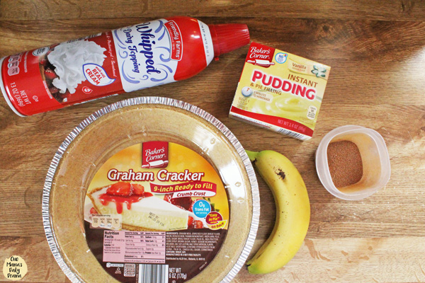 pie ingredients: whipped cream, pudding mix, spices, banana, and pie crust