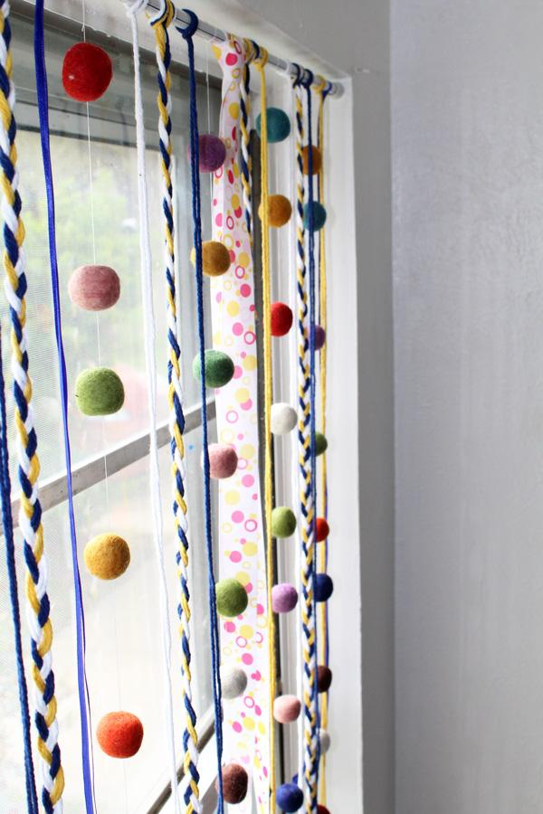 ribbons, braided yarn, and felt ball garland
