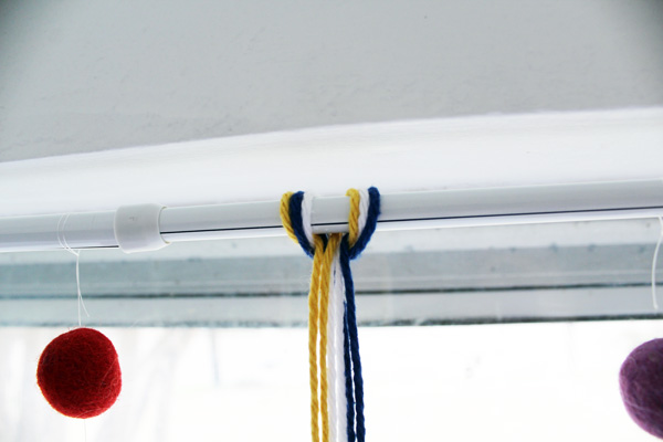 yarn tied over a tension rod