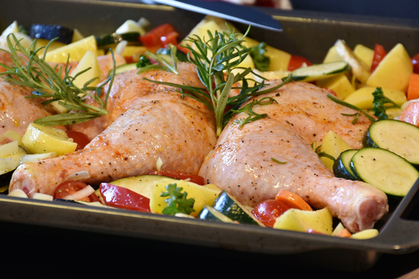 pan of chicken and vegetables with fresh rosemary