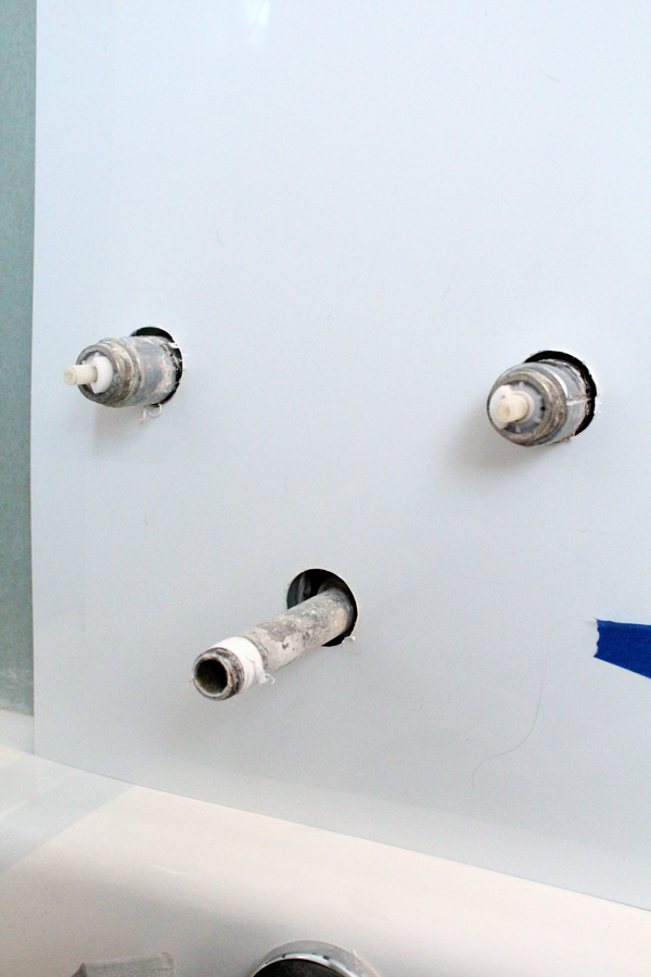 bathtub surround: cutting holes for the pipes