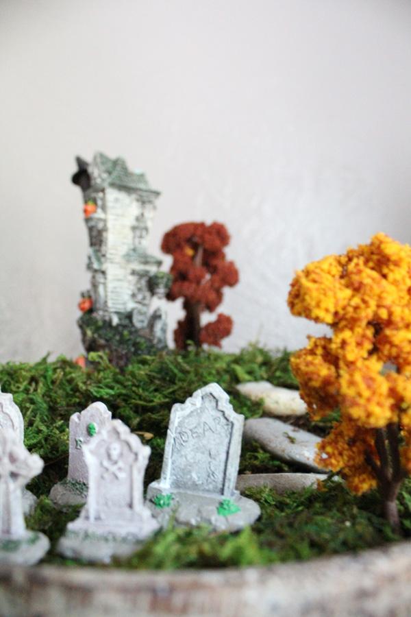 view of terrarium from behind tombstones looking toward house