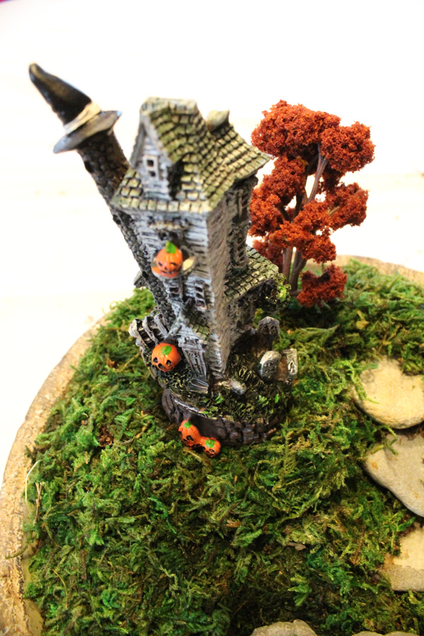 closeup of miniature resin witch house