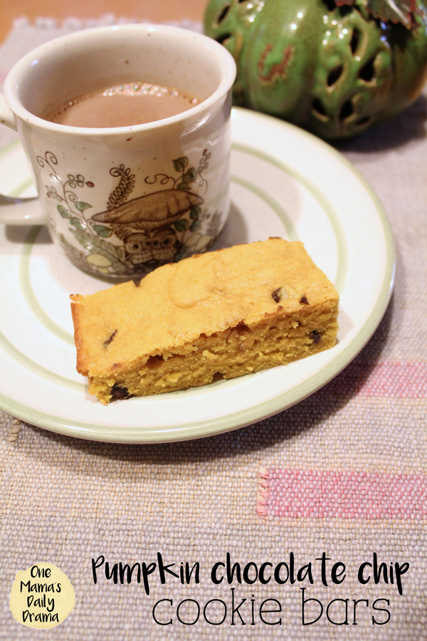 Pumpkin chocolate chip cookie bars with a mug of hot cocoa