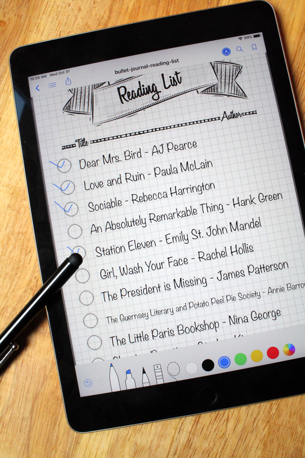 Close up on an iPad with a reading list with a few titles checked off