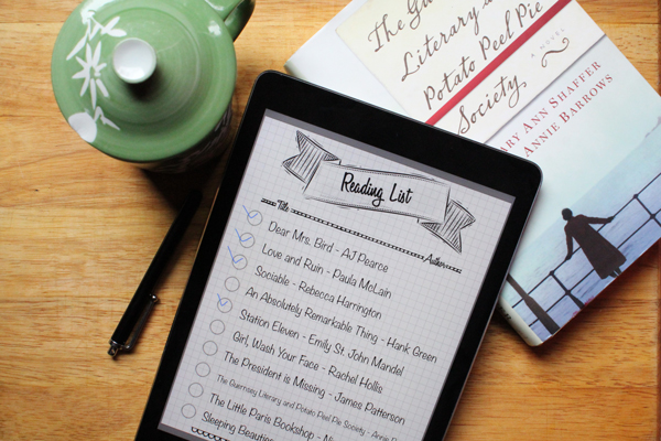 Reading list on an iPad with books checked off