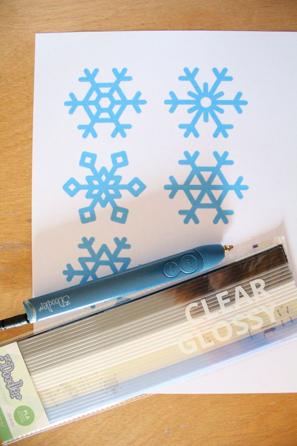 printed paper snowflake template and 3Doodler and PLA material in clear glossy