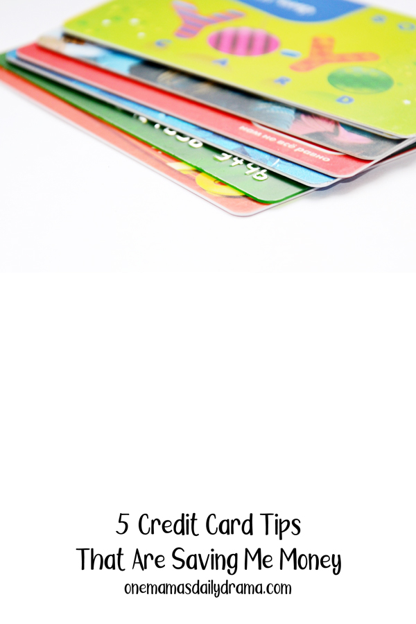 stack of credit cards on a white table