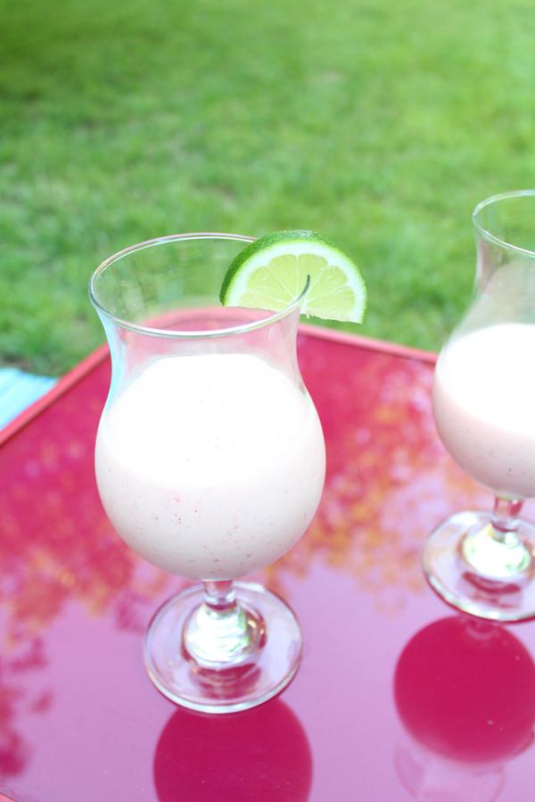 pink margarita shake in a clear hurricane glass