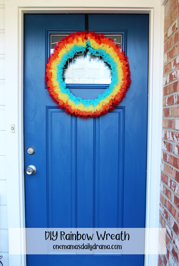 rainbow colored wreath on a blue front door