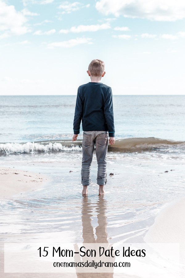 young boy standing on a beach