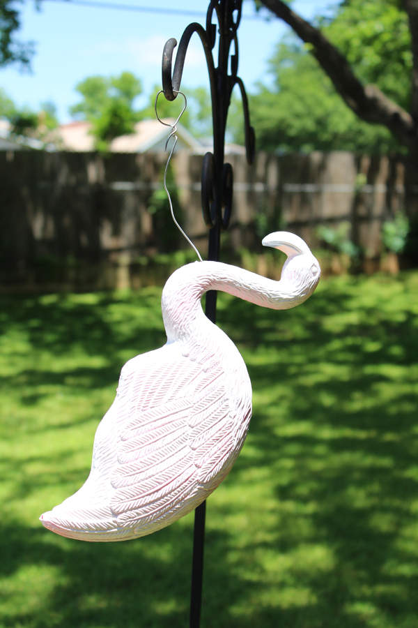 white flamingo hanging to dry