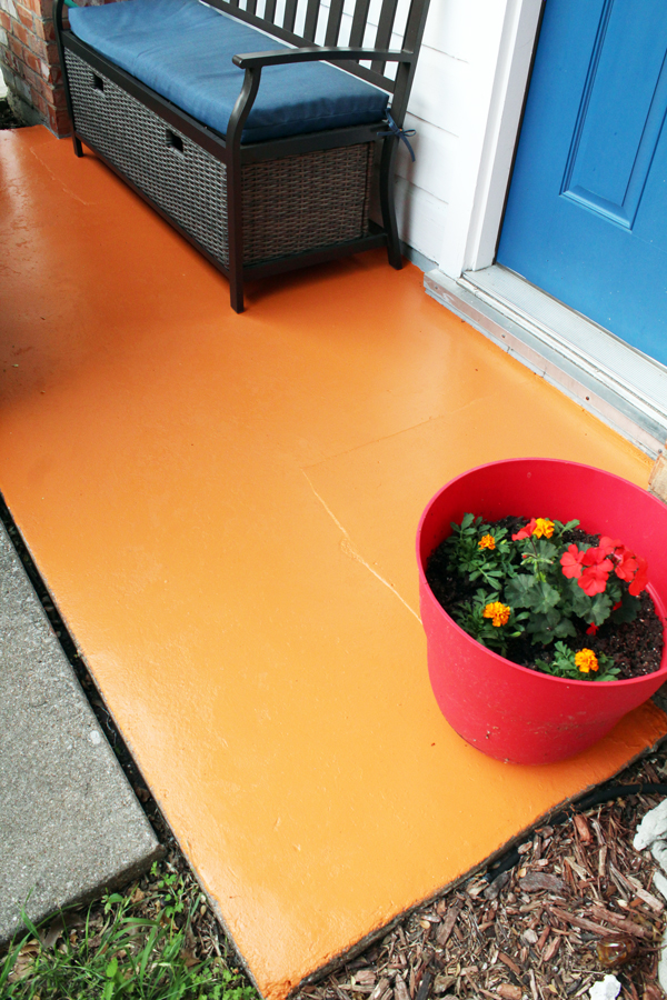 front porch after: smooth, orange concrete