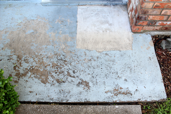 front porch before: dull, damaged concrete