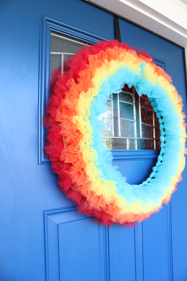 side view of completed rainbow wreath on front door