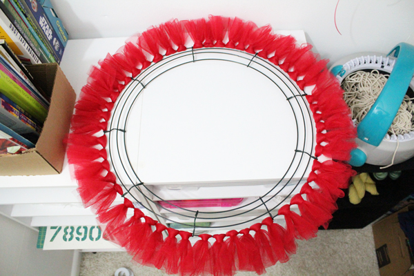 wreath frame with a complete row of red tulle