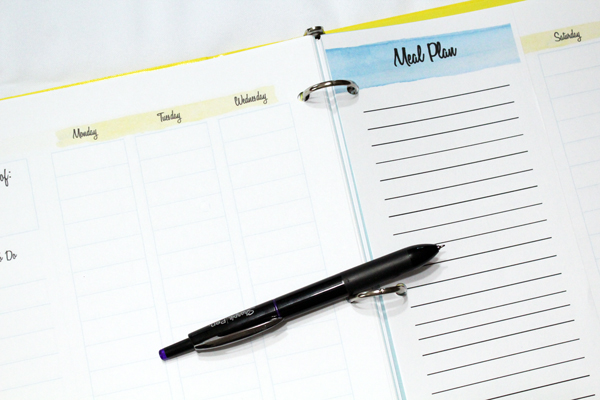 half-sheet meal plan list in a planner binder
