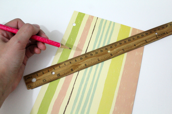 a ruler diagonal across a striped piece of paper