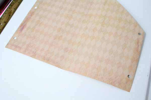 pink scrapbook paper unfolded with one corner cut off