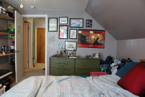 bedroom with a green dresser and gallery wall of My Little Pony and Harry Potter art