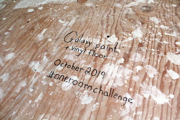 "subflooring with a message written in paint pen that says ""Galaxy paint + vinyl floor October 2019 #oneroomchallenge"""