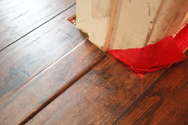 closeup of a wooden floor threshold with a T-joint