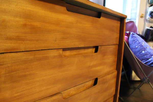closeup of wooden dresser drawers