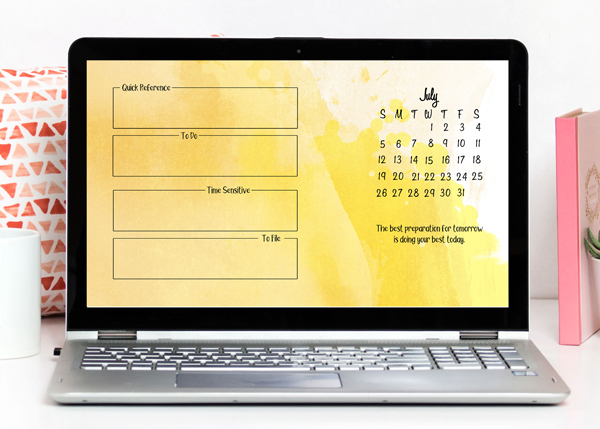 laptop computer screen displaying the July calendar and organizer