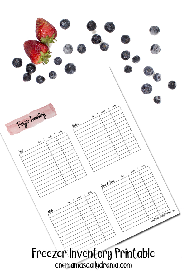 freezer inventory printable sheet on a white surface beside blueberries and strawberries